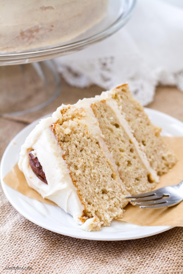 This maple cream cake recipe uses cake mix as a base to make a stunning yet simple cake! Topped with a rich cinnamon cream cheese frosting and spiced sugared pecans, this cake is a winner!
