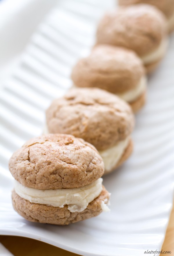 These easy pumpkin spice whoopie pies begin with cake mix and end with a spiced cream cheese frosting!
