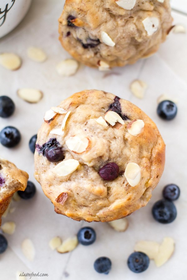 This easy blueberry almond muffin recipe is made with bananas, honey, and Greek yogurt instead of butter, oil, and refined sugar! These are light, fluffy, and amazingly delicious. You won't feel guilty after eating one of these!