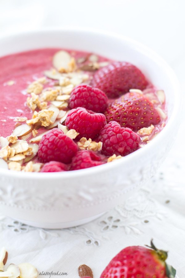 This easy breakfast recipe uses raspberries, strawberries, almond milk, and Greek yogurt to make the prettiest, tastiest smoothie bowl!
