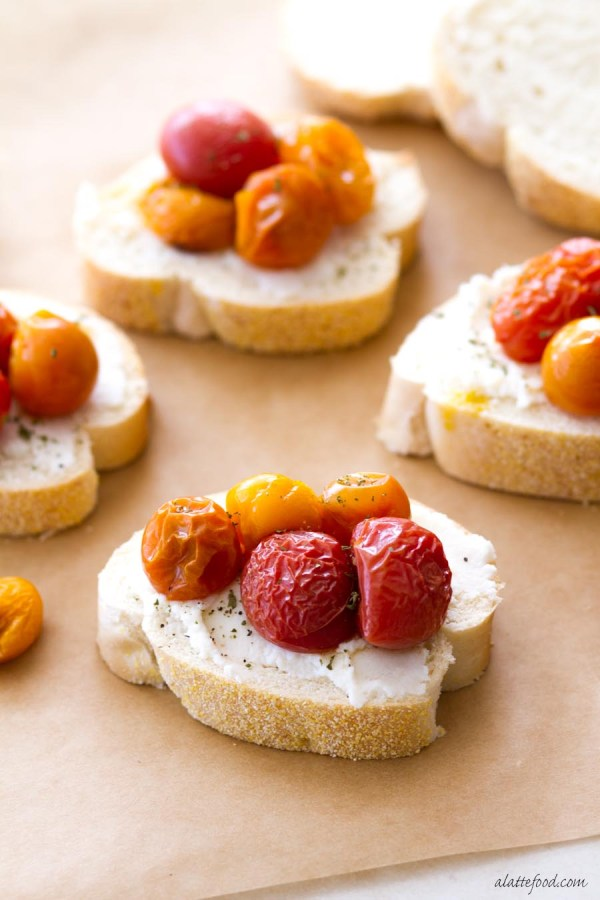 This easy appetizer recipe is perfect for any party or get together! With roasted tomatoes and ricotta cheese, this bruschetta recipe is a fun twist on a classic!