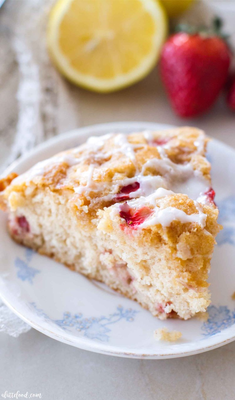 This strawberry lemon coffee cake recipe is light, fluffy, and packed with sweet strawberry and tangy lemon flavor! This easy coffee cake recipe makes for the best breakfast or brunch recipe! And, thanks to the flavors, it's the picture of spring.homemade coffee cake, the best coffee cake recipe, strawberry coffee cake, lemon cake