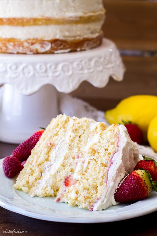 This Berry Vanilla Naked Cake is sweet vanilla cake swirled with a homemade berry puree and frosted with the dreamiest lemon whipped cream! This cake is light, fluffy, and the prettiest cake for spring!