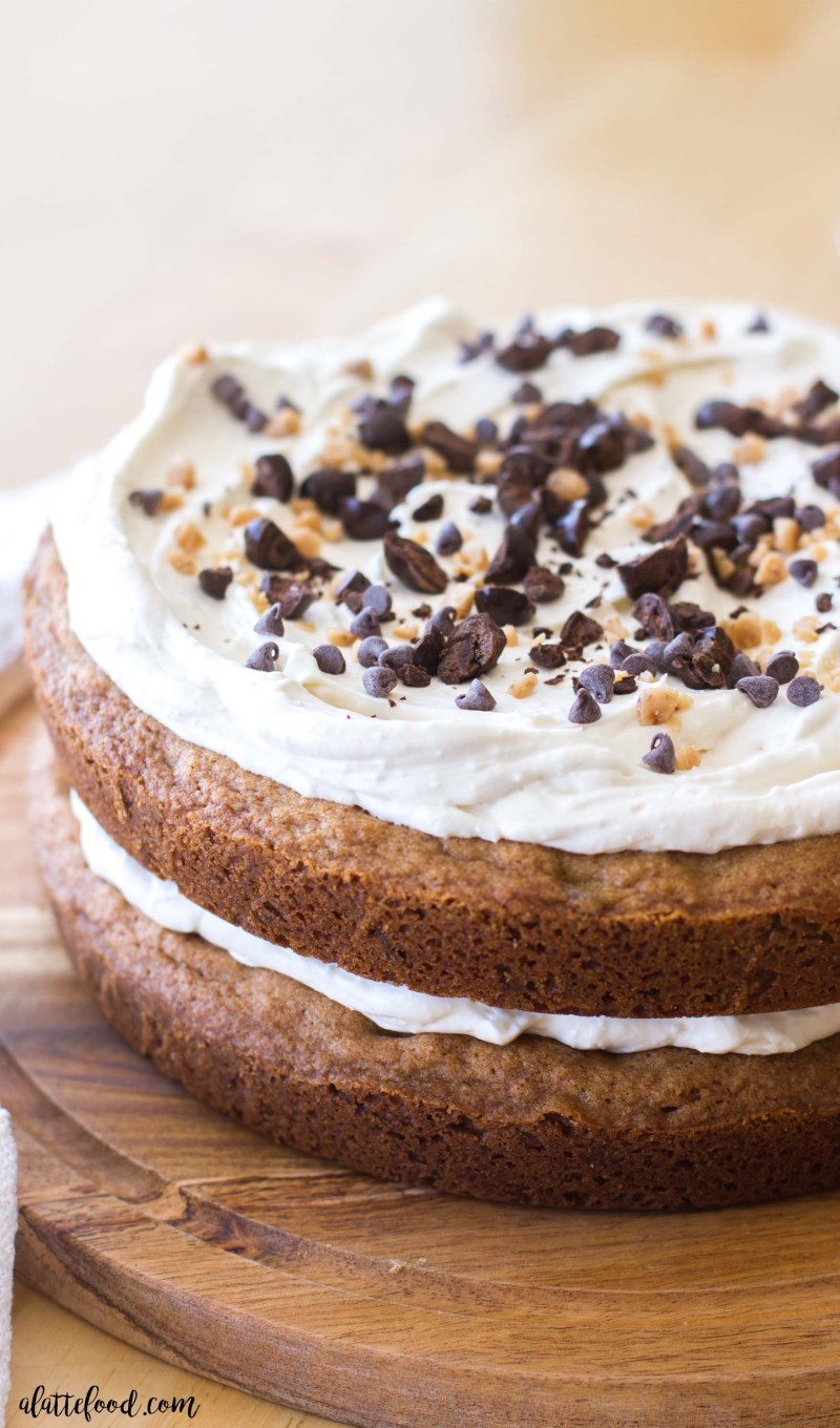 This easy chocolate chip cookie cake is the perfect chocolate dessert recipe for any chocolate lover! My favorite chocolate chip cookie recipe is baked into two giant cookies, filled with coffee cream frosting, and topped with toffee bits, crushed espresso beans, and mini chocolate chips. Rich, chocolatey, and perfect.