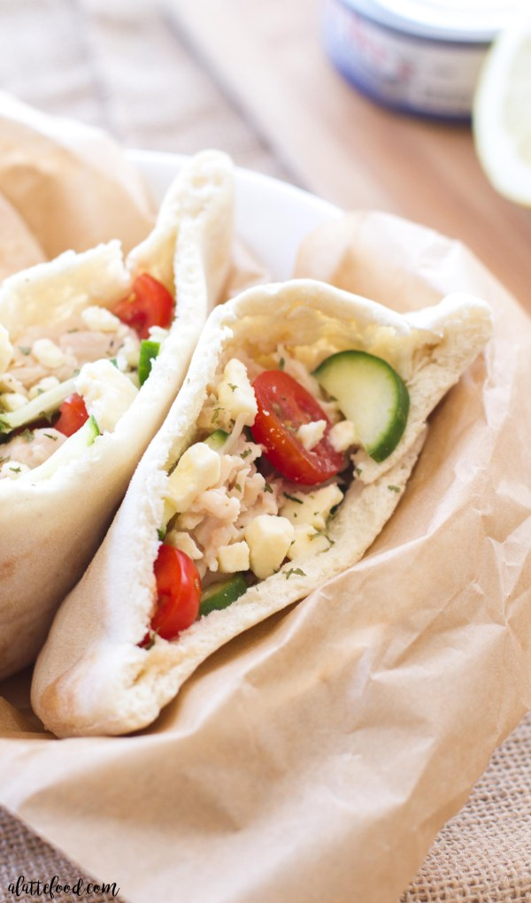 This easy Greek pita sandwich recipe is made with Bumblebee Albacore Tuna, a tangy lemon Greek yogurt sauce, cucumbers, tomatoes, and feta cheese. A simple weeknight dinner recipe!