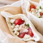 This easy Greek pita sandwich recipe is made with Bumblebee Albacore Tuna, a tangy lemon Greek yogurt sauce, cucumbers, tomatoes, and feta cheese. A simple weeknight dinner recipe!