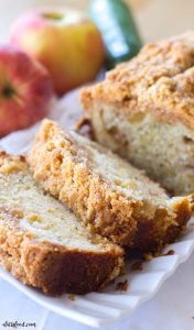 This easy zucchini apple crumb bread recipe is the perfect fall dessert! Filled with fresh apples and zucchini and topped with a brown sugar cinnamon crumb topping, this quick bread recipe is a fall staple!