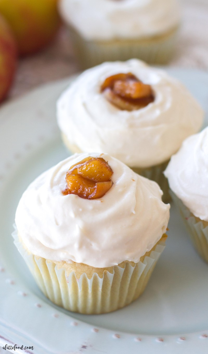 These homemade apple pie cupcakes are a light, fluffy cake filled with gooey apple pie filling and topped with a whipped cream frosting!