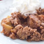 This easy apple dump cake recipe is made in the slow cooker! Only 6-ingredients stand between you and this amazing fall dessert!