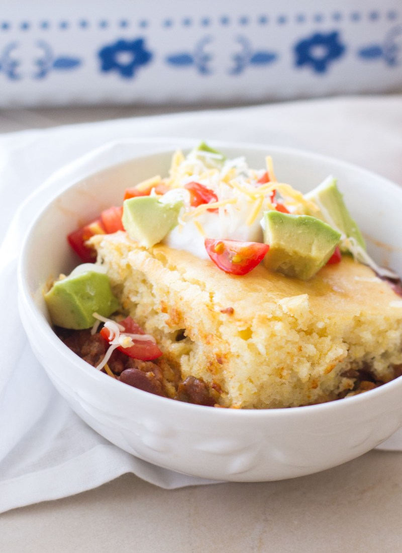This easy dinner recipe of chili and cornbread is classic comfort food! Homestyle chili is topped with cornbread and baked in the oven until golden brown!