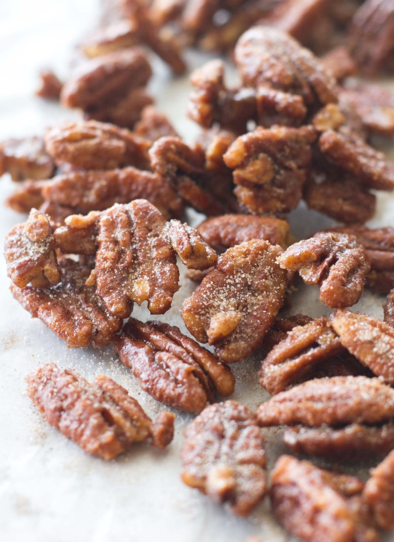 These easy maple candied pecans are made with maple syrup, brown sugar, white sugar, and cinnamon! Ready in less than 15 minutes!