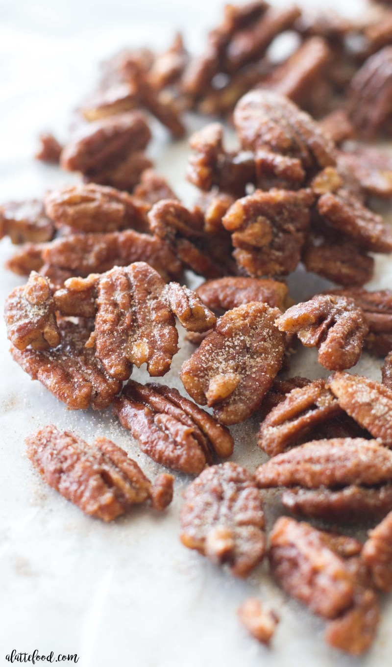 These easy maple candied pecans are made with maple syrup, brown sugar, white sugar, and cinnamon! Ready in less than 15 minutes! Homemade candied pecans for the fall dessert win.