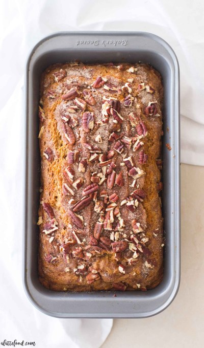 This easy Pumpkin Pecan Banana Bread recipe is one of my favorite fall dessert recipes! A sweet homemade banana bread is crossed with moist pumpkin bread (and topped with cinnamon sugar and crushed pecans) to make a perfectly spiced pumpkin banana bread! easy pumpkin bread, homemade pumpkin banana bread, best banana pumpkin bread