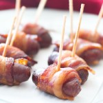 These bacon wrapped smokies are such an easy appetizer! Made in the slow cooker, these little smokies are wrapped in bacon, and cooked in a peach barbecue sauce!