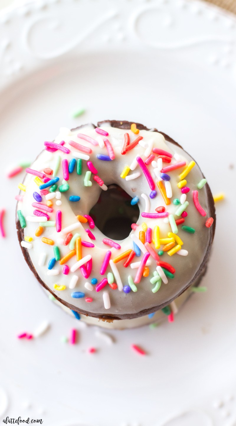 These classic baked chocolate donuts are topped with a homemade vanilla glaze and lots of prettysprinkles! These Chocolate Sprinkle Donuts are my favorite baked donut recipe (because, chocolate) and they make a perfect easy weekend breakfast! easy chocolate donut recipe, how to make baked chocolate donuts, chocolate sprinkle donuts