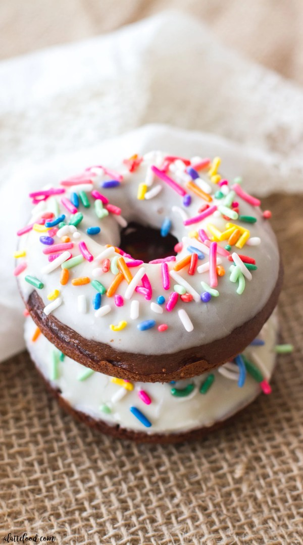 These classic baked chocolate donuts are topped with a homemade vanilla glaze and lots of pretty sprinkles! These are perfect for breakfast, brunch, and dessert!