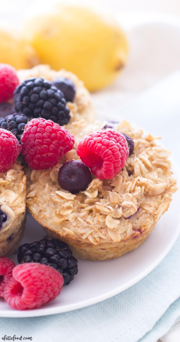 These easy baked oatmeal cups are full of sweet berries and lemon flavor! This healthy breakfast is hearty and can easily be made ahead of time!