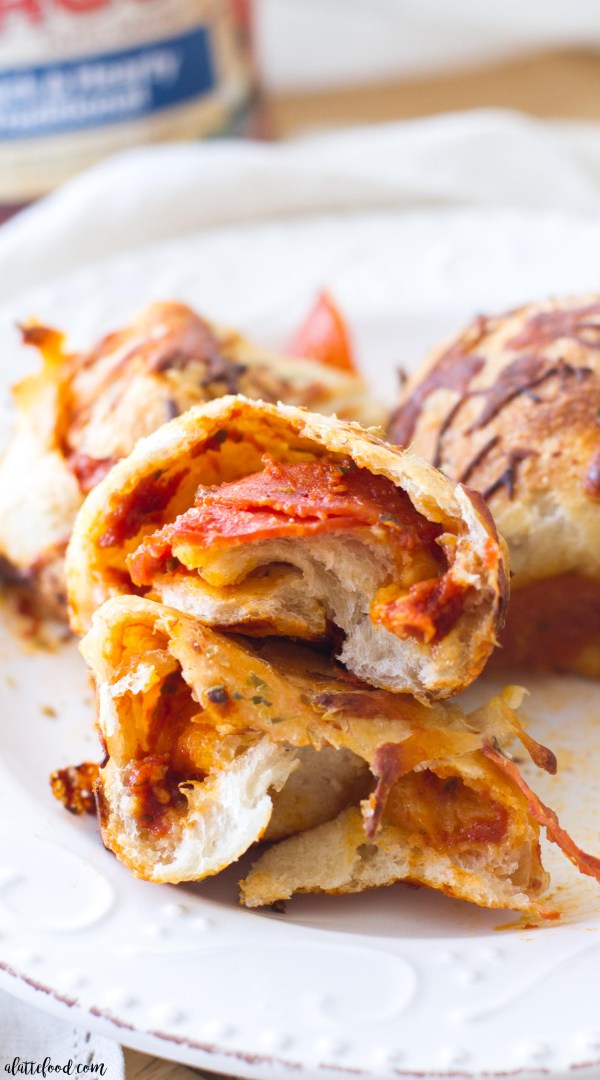 This easy appetizer recipe for Cheesy Pepperoni Pizza Bites is sure to be a hit! They are filled with simple ingredients and come together quickly! Made with RAGÚ®, this is the perfect tailgating or homegating!