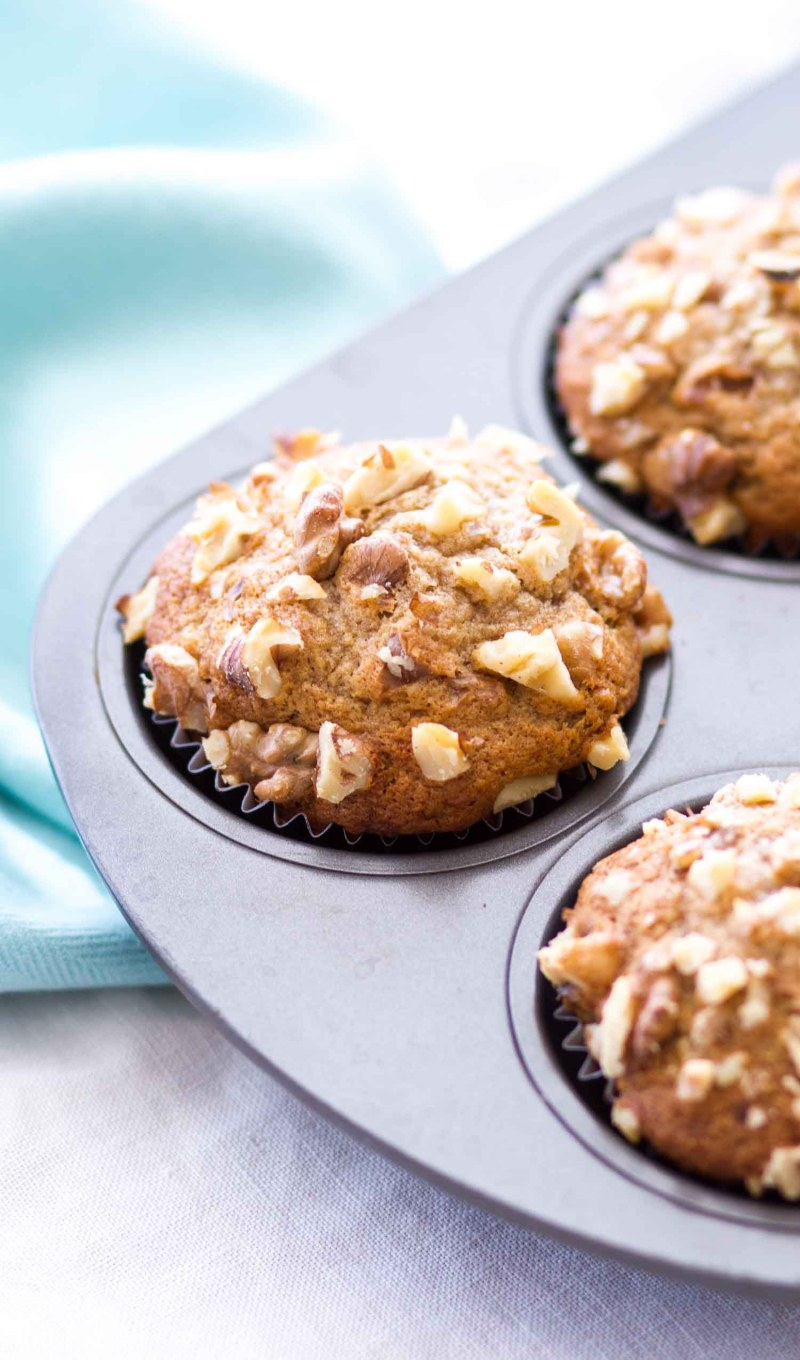banana muffins with walnuts in muffin tin