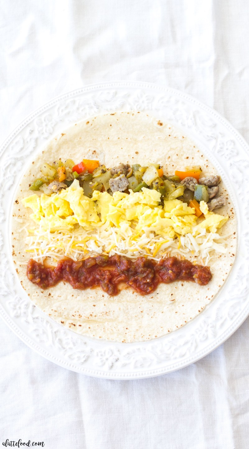 These easy Baked Southwestern Breakfast Taquitos are full of scrambled eggs, sausage, potatoes, green chiles, bell peppers, and salsa. This simple breakfast is sure to be a family favorite!