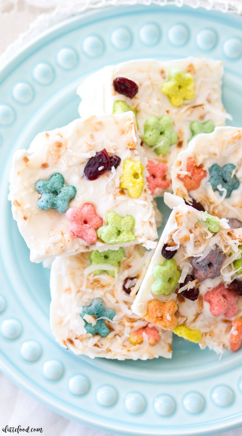 This easy Frozen Greek Yogurt Cereal Bark is made with Vanilla Greek Yogurt, Malt-O-Meal Fruity Stars, toasted coconut, and dried cranberries! This Greek Yogurt Bark is incredibly simple to make, the perfect breakfast or after-school snack, and so fun and colorful!