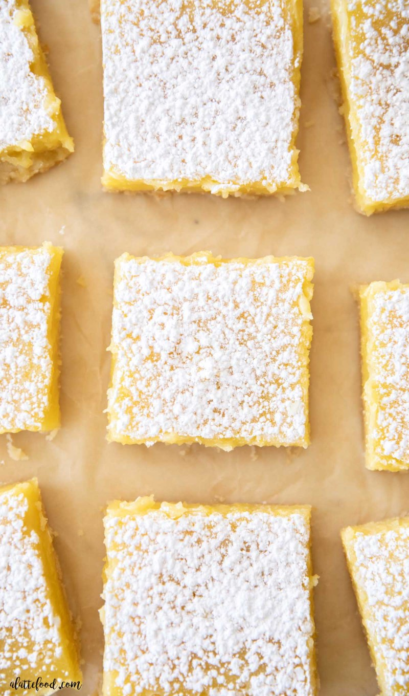 overhead view of lemon bars dusted with powdered sugar