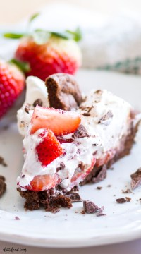 This Double Chocolate Chip Cookie Strawberry Nutella Cream Pie is a chocolate lovers dream! This Nutella Cream Pie starts with a double chocolate cookie crust, has a layer of strawberries and Nutella Cream, and is topped with whipped cream! Crumbled cookies and extra strawberries make this Nutella chocolate pie irresistible!