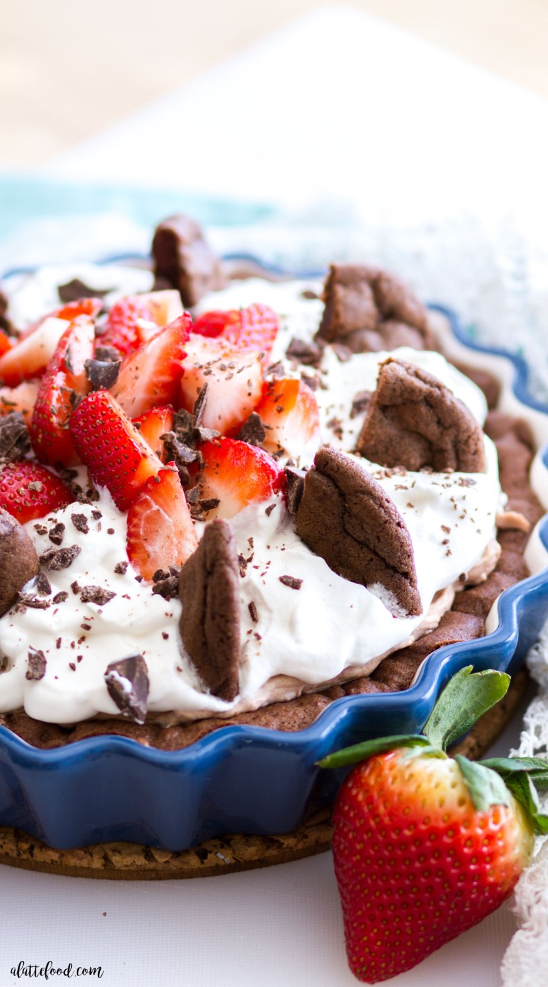 This Double Chocolate Chip Cookie Strawberry Nutella Cream Pie is a chocolate lovers dream! This Nutella Cream Pie starts with a double chocolate cookie crust, has a layer of strawberries and Nutella Cream, and is topped with whipped cream! Crumbled cookies and extra strawberries make this Nutella chocolate pie irresistible! chocolate, pie, nutella, chocolate cream pie