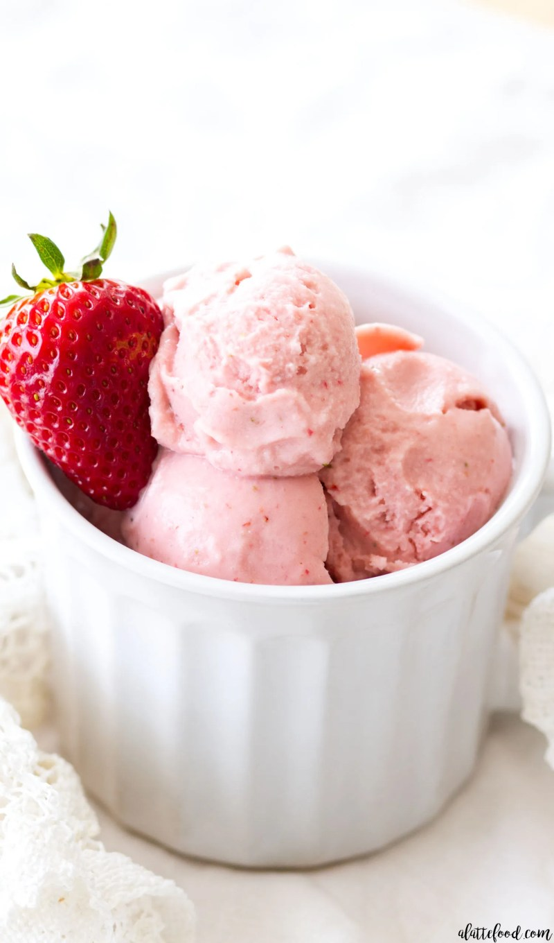 This homemade Strawberry Buttermilk Ice Cream is made with 6-ingredients! This easy strawberry ice cream recipe is smooth, creamy, and the perfect summer dessert! ice cream, strawberry, strawberry ice cream