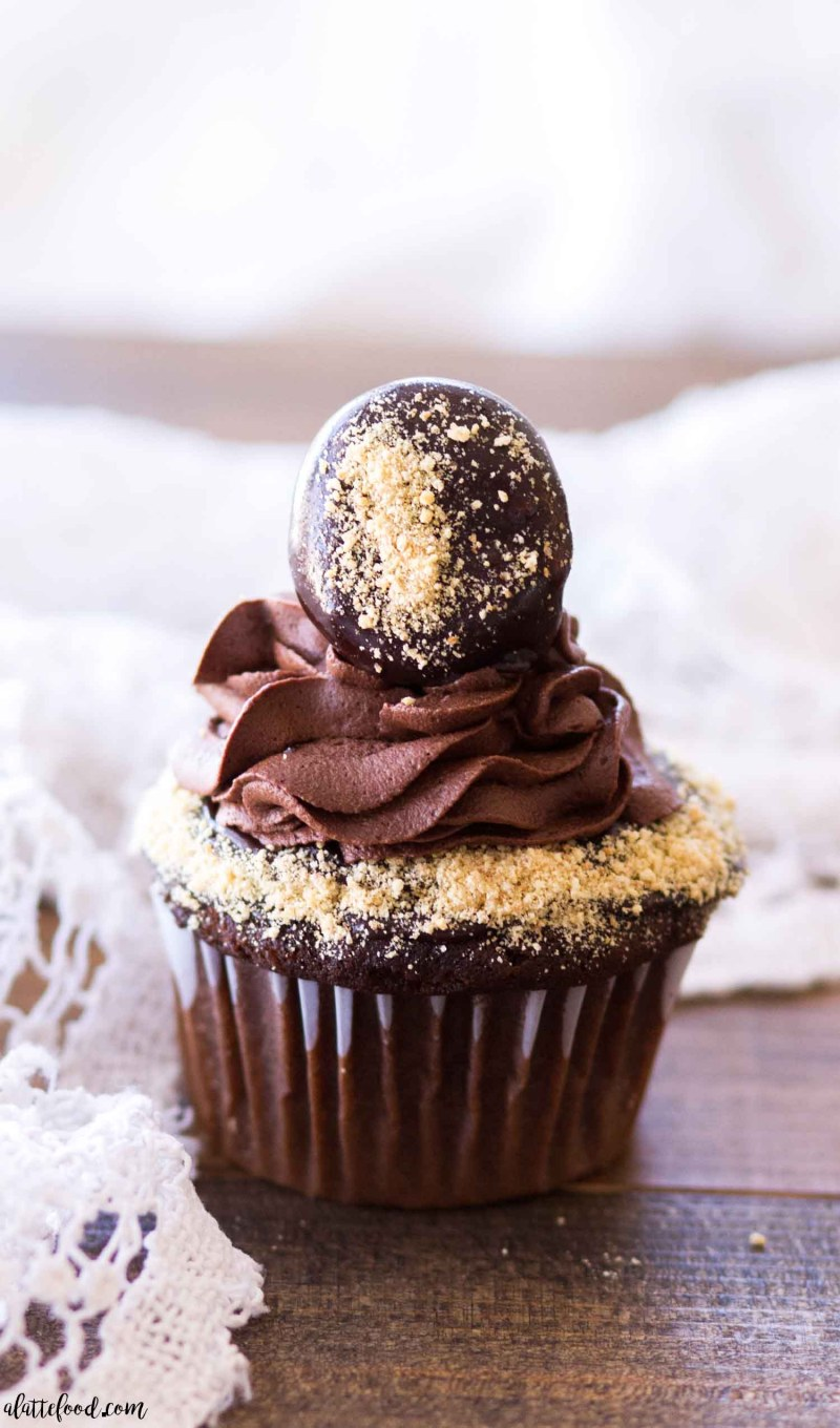 s'mores chocolate cupcake on wood platter