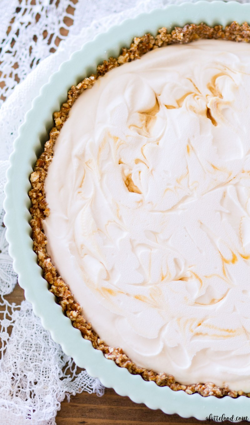 This easy No Bake Caramel Macchiato Ice Cream Pie is made with homemade caramel ice cream and sits on a pretzel crust! When topped with homemade mocha ganache, this ice cream pie is the perfect summer dessert! no churn ice cream, caramel ice cream, homemade ice cream recipe