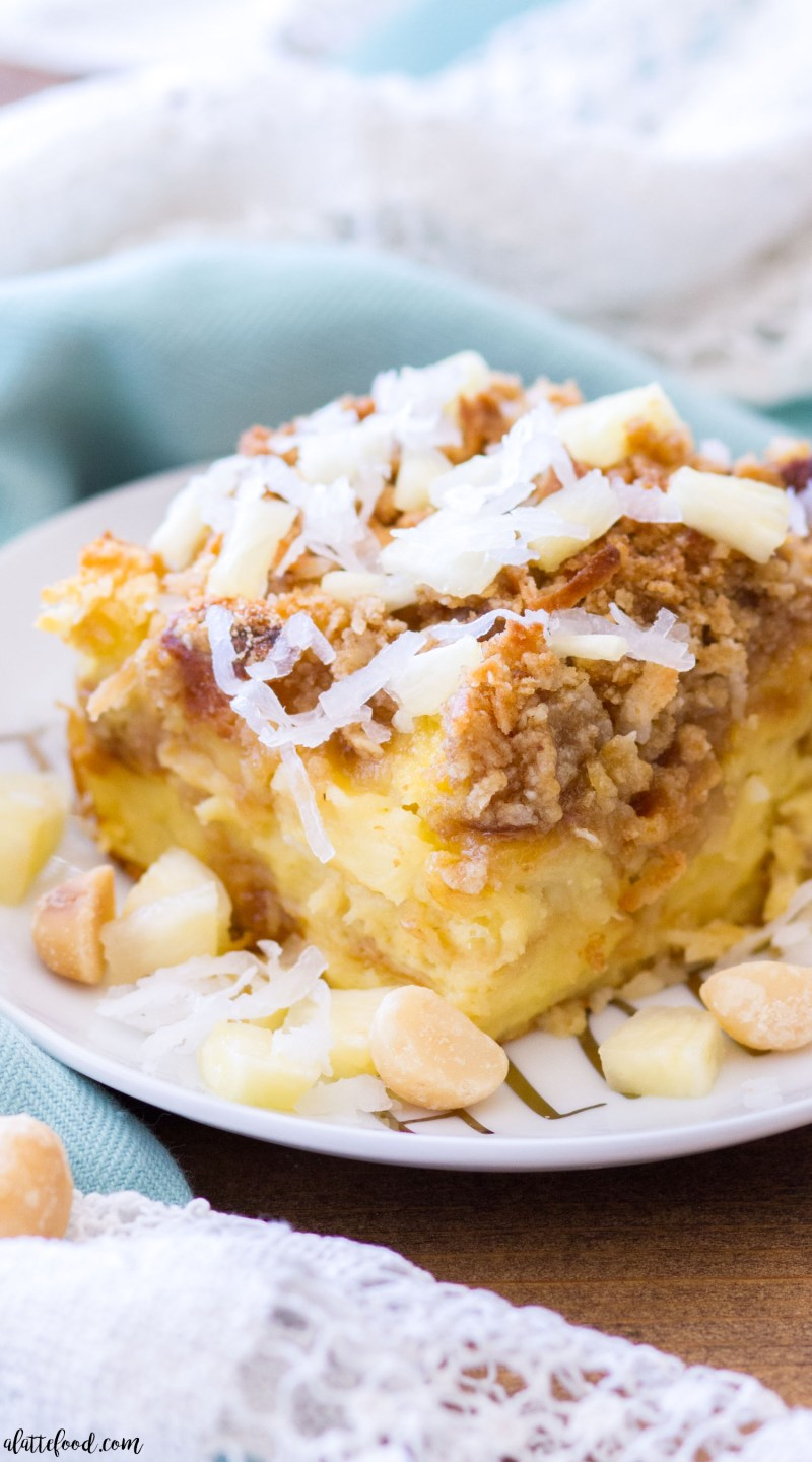 This tropical Pineapple Coconut French Toast Casserole is made with King's Hawaiian Sweet Rolls, Del Monte Pineapple, Coconut, and Mauna Loa Macadamia Nuts! It's an easy French Toast Casserole recipe that is full of sweet tropical flavor, perfect for breakfast or brunch! best french toast casserole, easy brunch recipes, homemade french toast casserole recipe