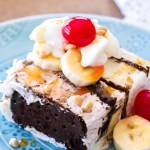 This Banana Split Ice Cream Sandwich Cake is a fun twist on the classic banana split dessert. Ice Cream Sandwiches, bananas, caramel sauce, hot fudge, whipped cream, and cherries make up this super pretty ice cream dessert! This easy no bake ice cream sundae dessert is the perfect way to cool off during the summer! ice cream cake, ice cream sandwich cake, ice cream sundae cake