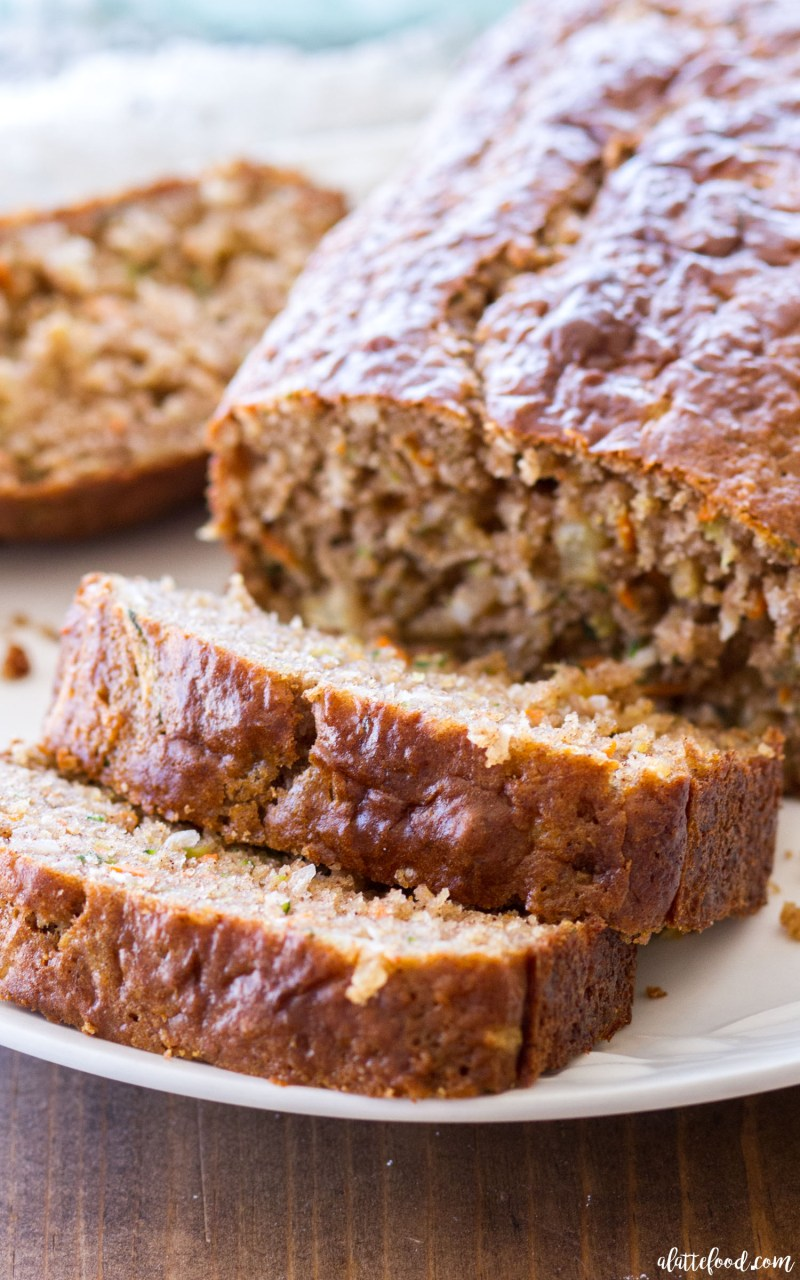 This homemade zucchini bread recipe is filled with shredded carrots, sweet pineapple, and coconut! Pineapple Carrot Zucchini Bread is spiced with ginger and cinnamon, and the perfectquick bread for breakfast, brunch, or an after school snack! Plus, a video below!