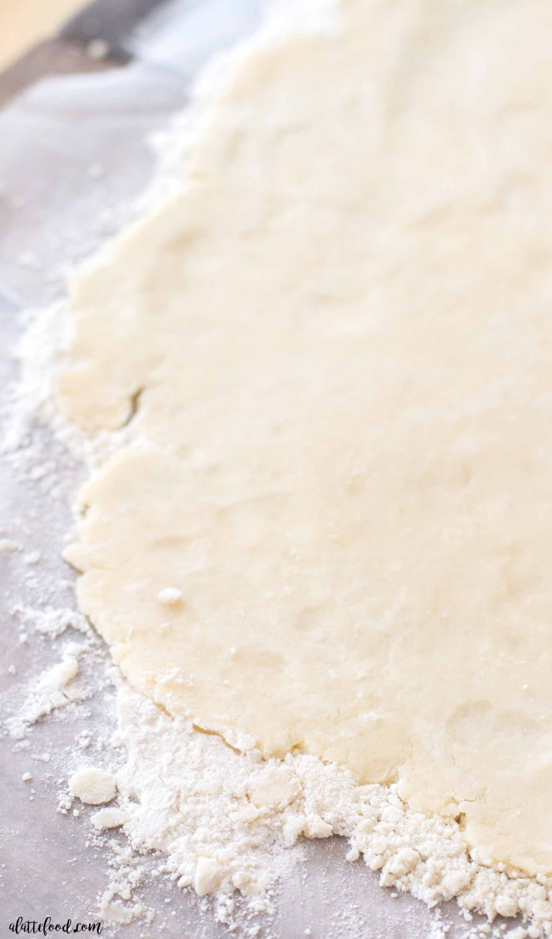 Easy Cream Cheese Pie Crust -- This easy homemade pie crust is made with both cream cheese and butter, giving it a rich flavor and flaky texture! This homemade pie dough recipe is so simple to make, and it is perfect for any baked pie (pumpkin pie, apple pie, cherry pie, etc.)! Make this Easy Cream Cheese Pie Crust for Thanksgiving or Christmas!