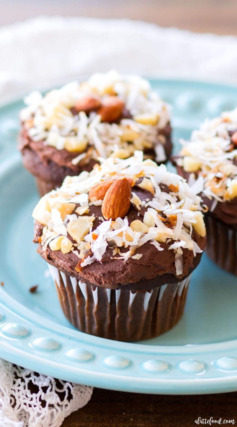 These rich chocolate cupcakes are filled with sweet flavors of toasted coconut, macadamia nuts, and almonds. These homemade chocolate cupcakes are topped with whipped ganache frosting! These Nutty Hawaiian Chocolate Cupcakes are the perfect dessert all year long!
