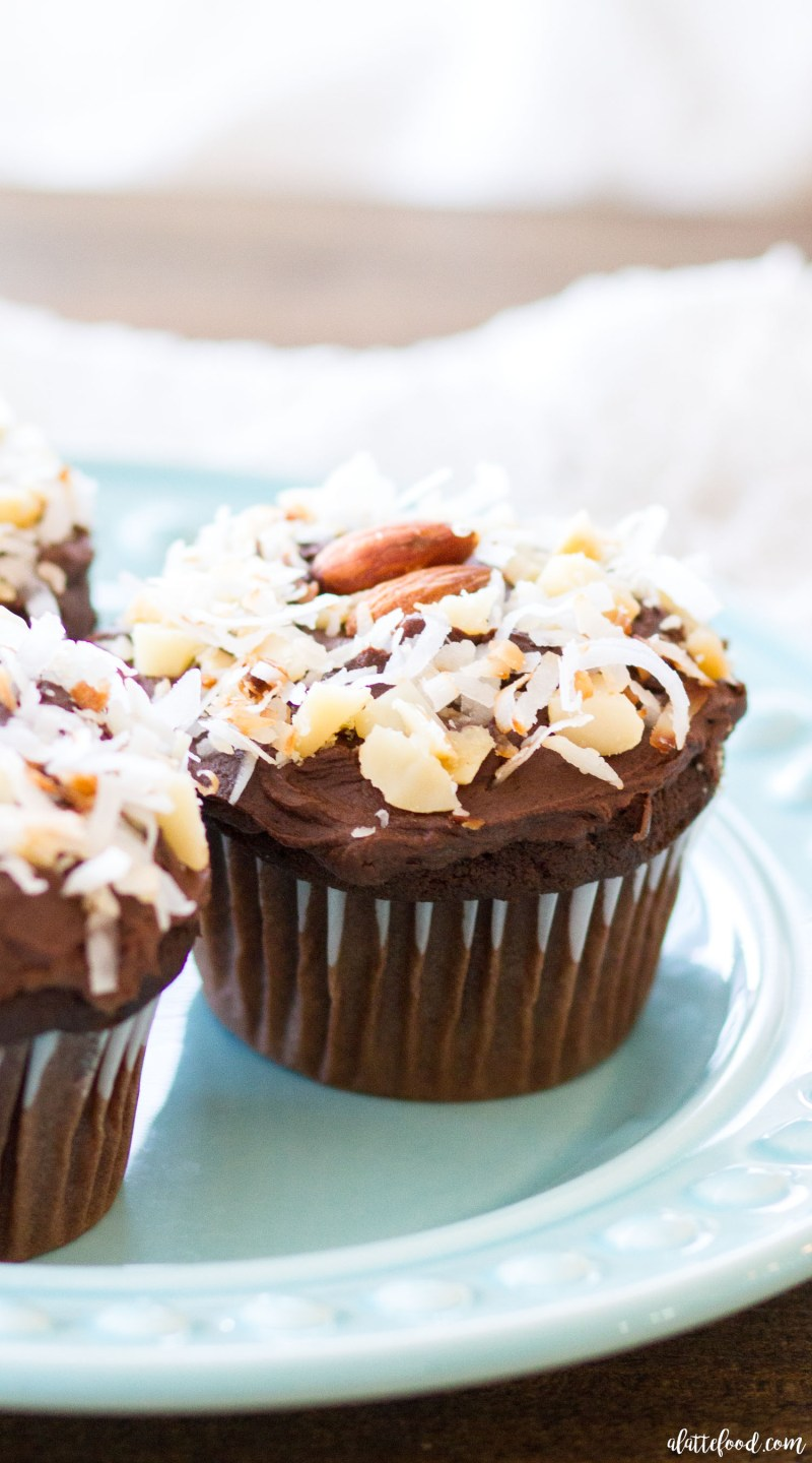 These rich chocolate cupcakes are filled with sweet flavors of toasted coconut, macadamia nuts, and almonds. These homemade chocolate cupcakes are topped with whipped ganache frosting! These Nutty Hawaiian Chocolate Cupcakes are theperfect dessert all year long!