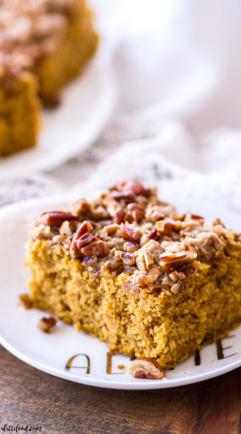 a small piece of pecan pumpkin coffee cake on a plate