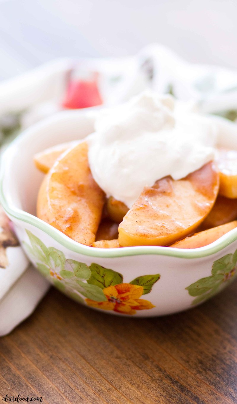 Slow Cooker Spiced Apples Recipe --These sweet slow cooker spiced apples taste just like homemade apple pie filling! These apples are cooked with maple syrup, apple pie spice, orange zest, apple cider (or apple juice), butter, and bit of corn starch (to thicken the juices), making a sweet holiday dessert that is so easy! Top with ice cream, caramel sauce, or whipped cream for an even more decadent easy Thanksgiving dessert or Christmas dessert! Plus, a step-by-step video below!