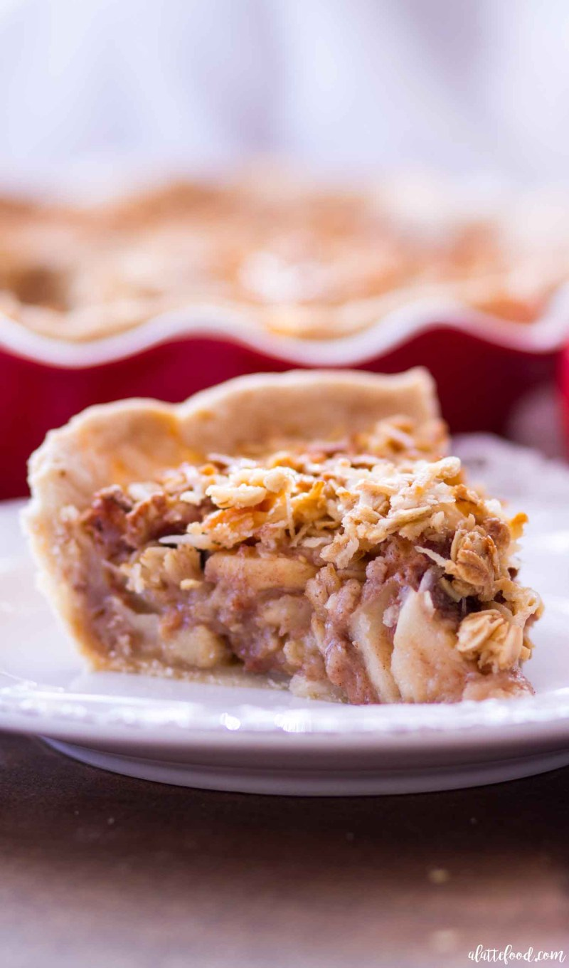 Maple Oatmeal Apple Pie - This sweet Maple Oatmeal Apple Pie is half apple pie, half maple oatmeal pie, combing two classic flavors to make one sweet, gooey, and amazing pie! This pie begins a homemade crust, has a layer of homemade apple pie, and finally a layer of maple oatmeal pie, making it the perfect dessert!