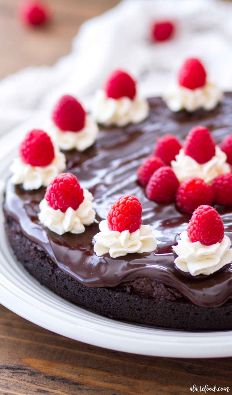 This Mocha Flourless Chocolate Cake is topped with a chocolate ganache and a whipped cream frosting. This easy homemade chocolate cake is rich, fudgy, and full of intense chocolate flavor. This is a perfect Valentine's Day dessert, or the perfect chocolate dessert for any day of the week! Plus, it's a great gluten-free dessert too!