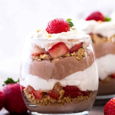 layered no bake chocolate cheesecakes in dessert glasses