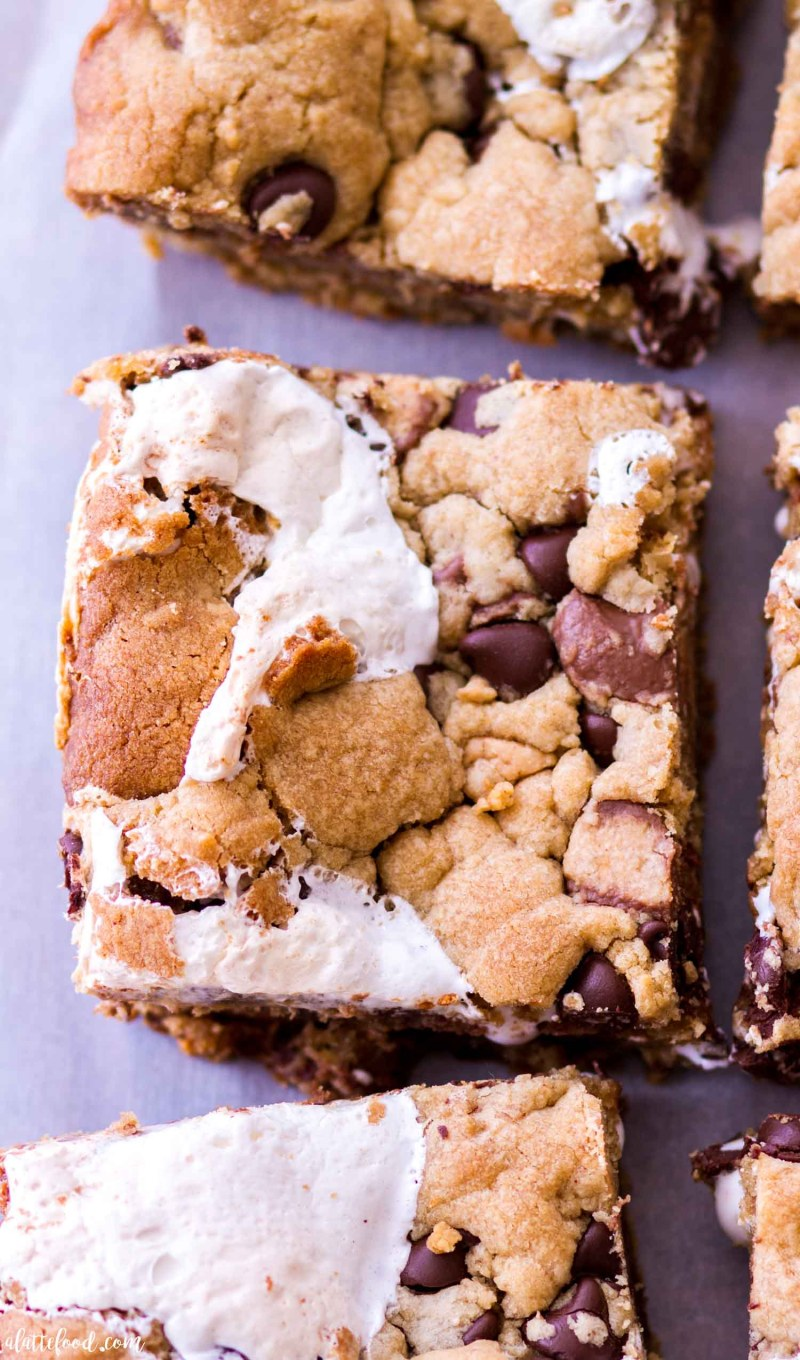 Three marshmallow peanut butter cookie bars on parchment paper