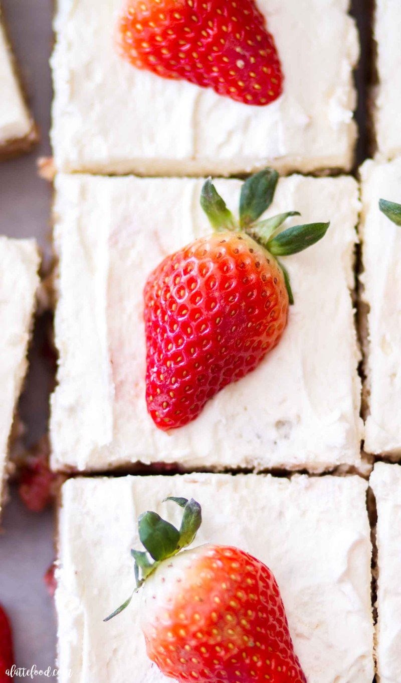 strawberry blondies with fresh strawberries and whipped cream