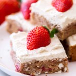 strawberry blondie dessert bars on white plate