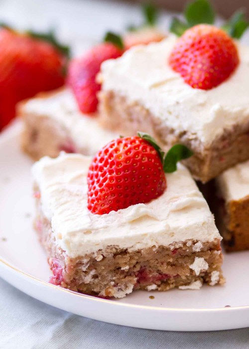 strawberry blondie dessert bars on white plate
