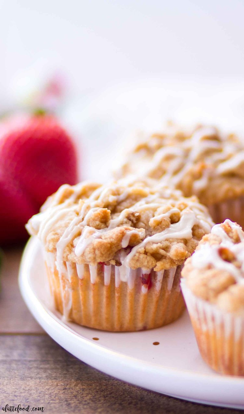 These homemade Strawberry Crumb Cake Muffins are made with fresh strawberries and topped with a crumb cake streusel and vanilla glaze! These easy strawberry muffins make a great breakfast, easy brunch recipe, or on-the-go snack! Plus, this Strawberry Crumb Cake Muffin recipe is ridiculously simple! Easy peasy.