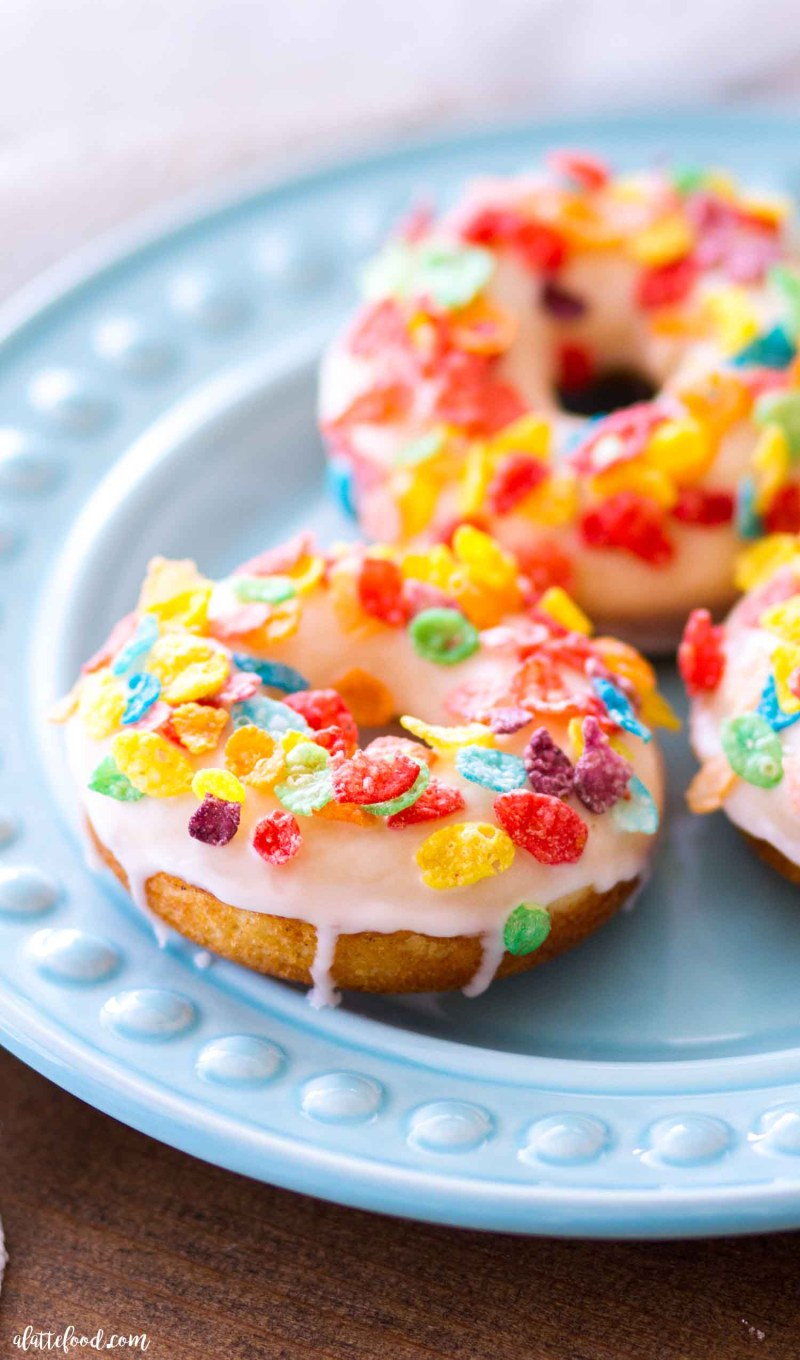 These Fruity Pebble Baked Vanilla Donuts (aka, cereal milk donuts) are made with sweet cereal milk, baked in the oven, and dunked in a cereal milk glaze. When topped with Fruity Pebbles, these yummy baked vanilla donuts make such a festive dessert or breakfast treat! Plus, these baked rainbow donuts are the perfect St. Patrick's Day breakfast (or St. Patrick's Day dessert)!