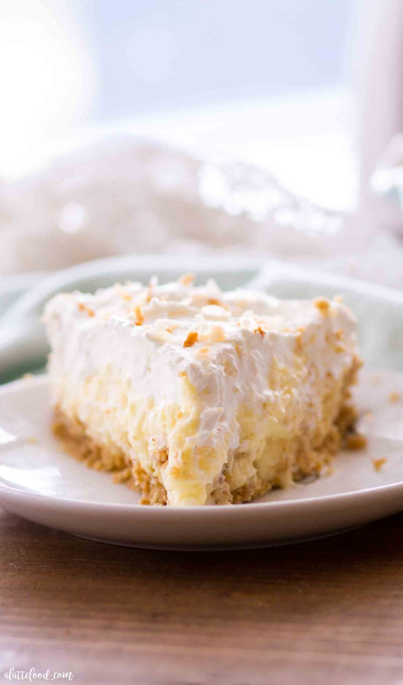 This homemade banana coconut cream pie recipe is a combination of banana cream pie and coconut cream pie in a homemade graham cracker crust! This no bake banana coconut cream pie is an easy dessert recipe perfect for spring or summer!