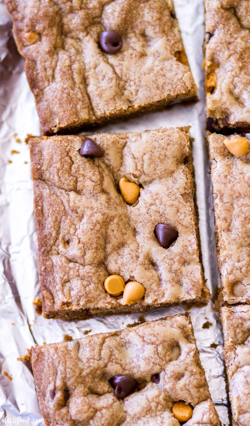 three cut chocolate butterscotch cookie bars on tin foil
